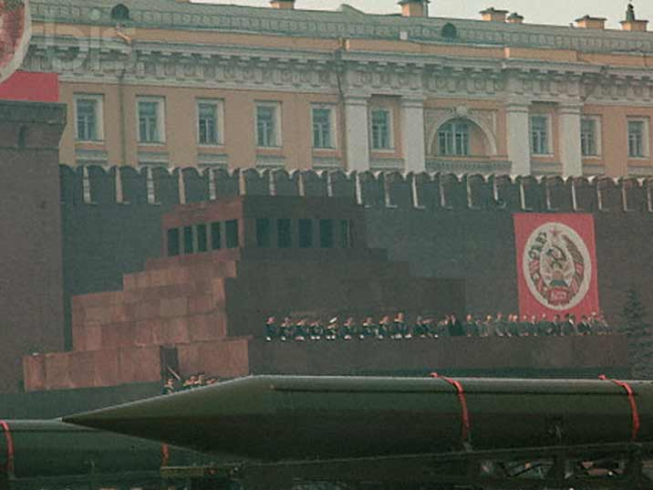 Tanks parading in front of the Lenin Mausoleum with the Politburo