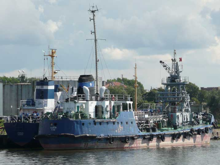 Two Soviet era utility ships docked in the Klaipeda harbour