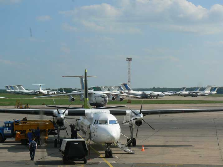 AirBaltic Fokker 50 at with many Il-76 aircraft in the background