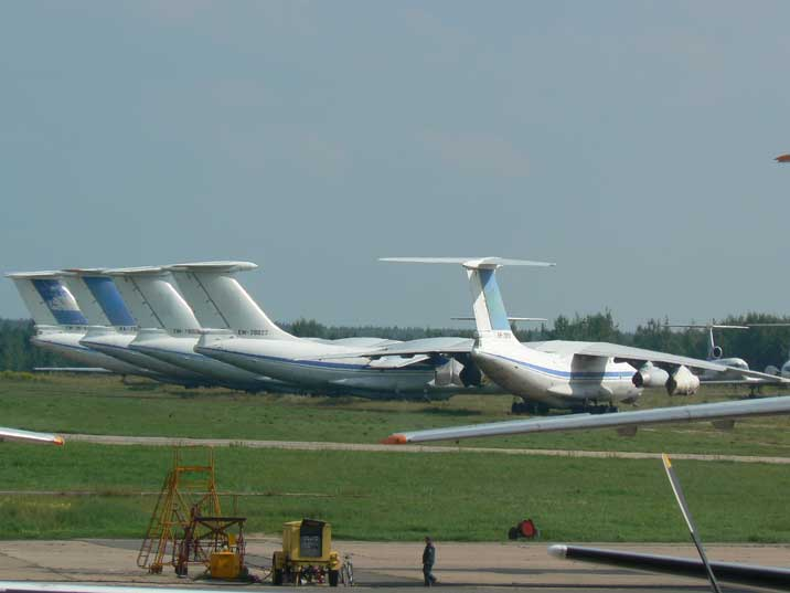 Five Ilyushin IL-76 aircraft seen from behind at Minsk airport