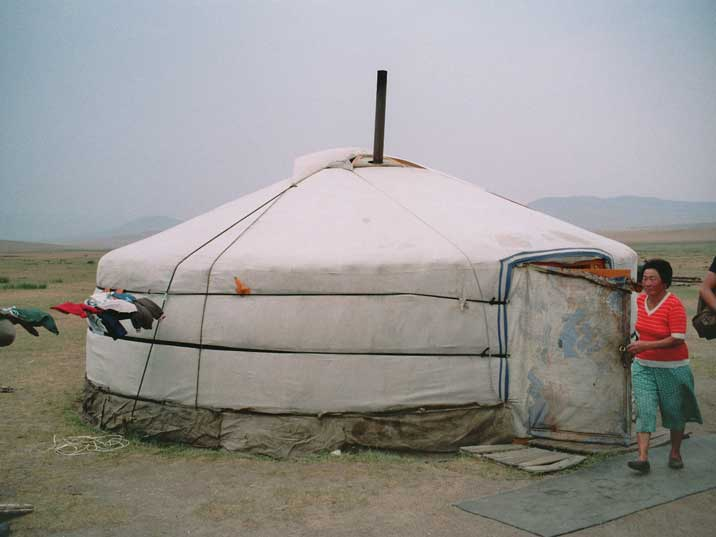 Mongolian lady has prepared the Ger for tourists at Estei Ger camp