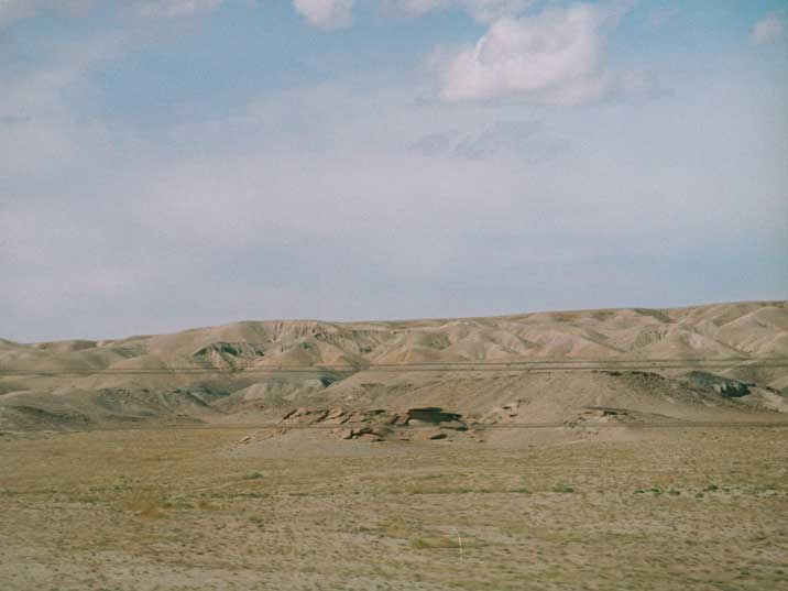 Hills of the Gobi desert seen from the train to China in Mongolia