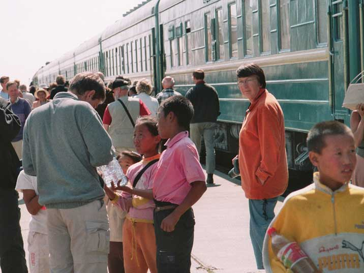 Kids selling water on the Ulan Bator Railway Station platform