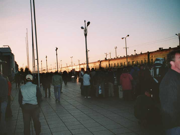 Train arriving on busy Ulan Bator Railway Station in the evening