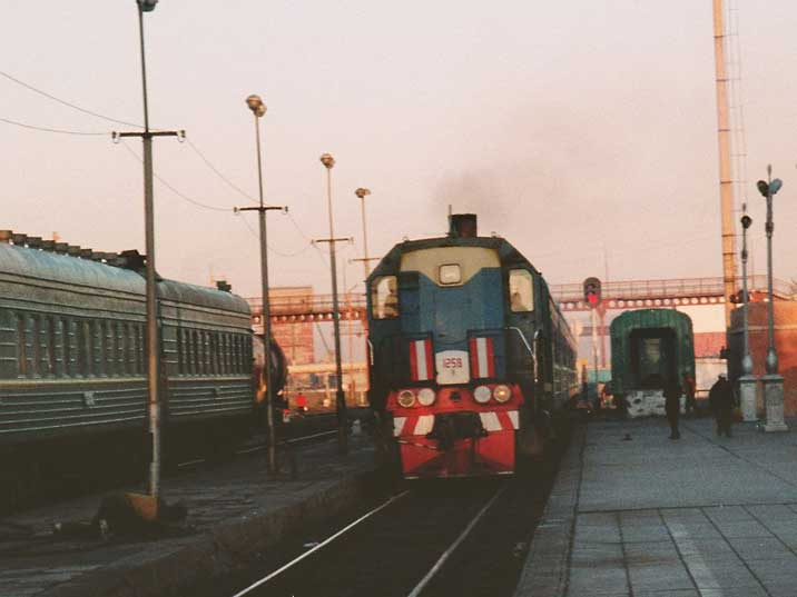 Diesel locomotive pulling in Ulan Bator Railway Station
