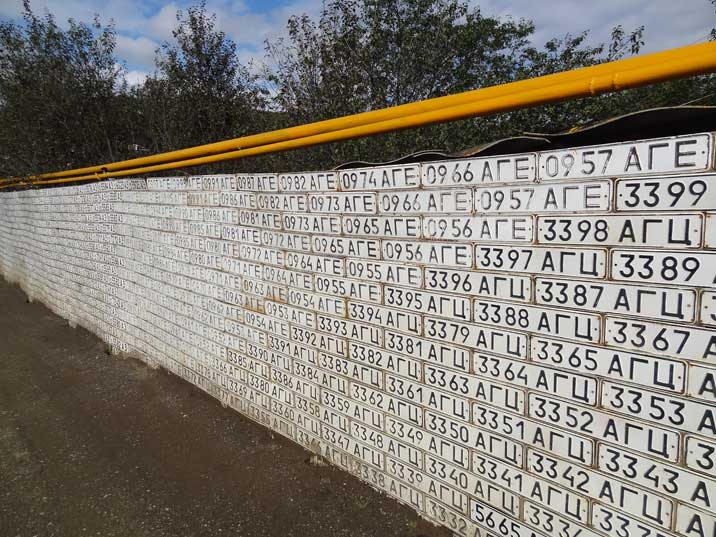 A wall in Vank decorated with license plates from Azeri cars that were left behind or destroyed during the war