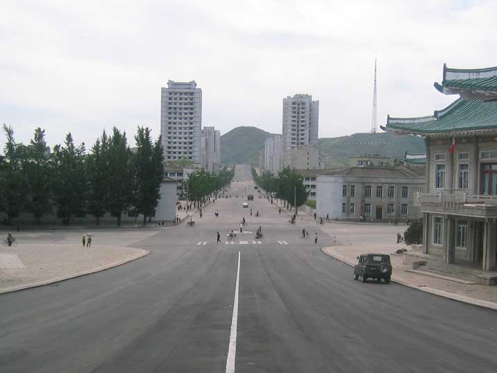 Crossroad with police agent arranging traffic in Kaesong