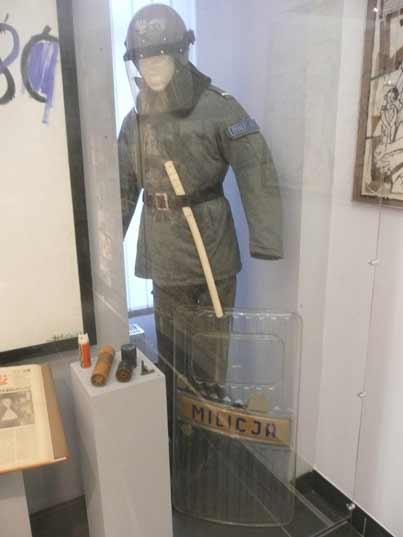 Uniform, shield, club and tar gas grenades as used by the police during the riots of the 1980s Nowa Huta