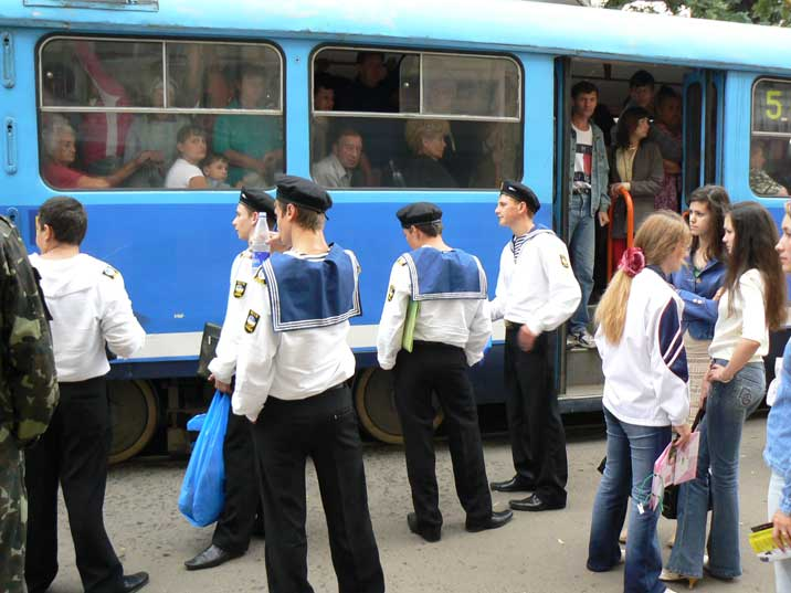 Odessa sailors and teenage girls if front of a packed tram