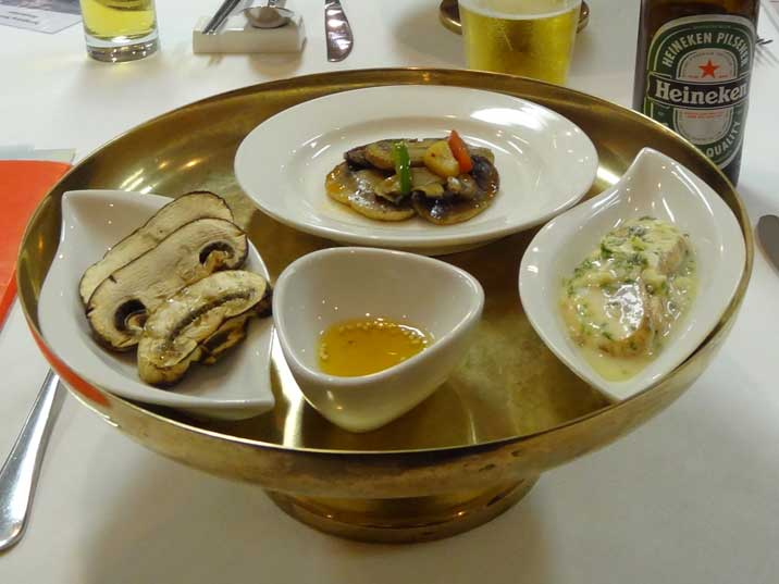 Large mushrooms served with oil and sesame seeds prepared in three Korean ways, grilled, cooked and stewed