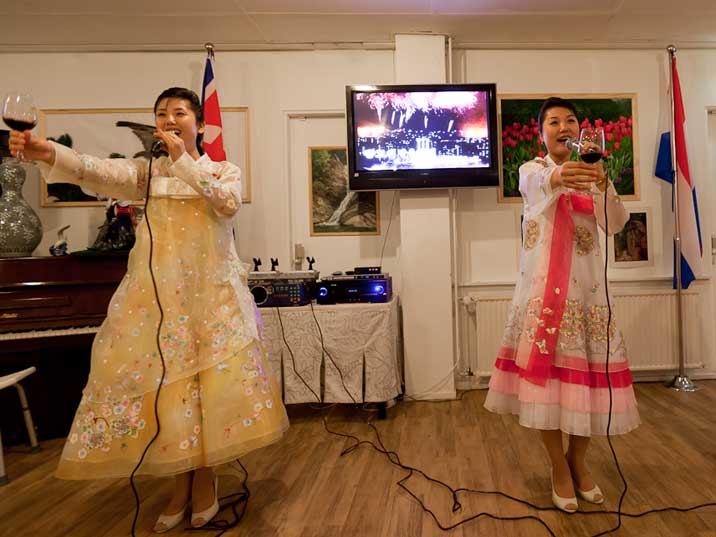 The waitresses sing a welcome song and do a toast for the guests of restaurant Pyongyang