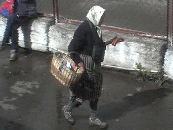 Old Russian woman selling sausages on Kirov train station