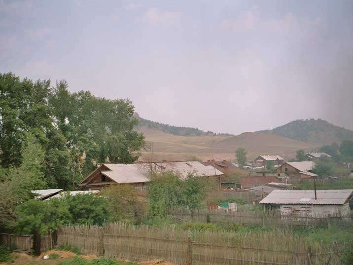 Siberian wooden houses seen from the Trans Siberia Express