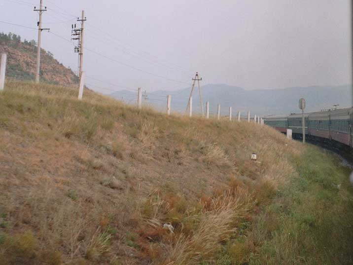 The long Trans Siberia Express train in the Russian landscape