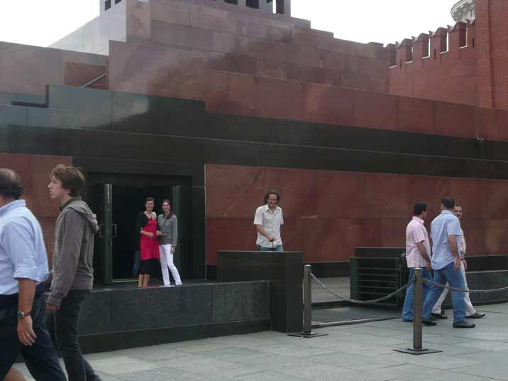 Visitors leave the Lenin mausoleum at the left side door