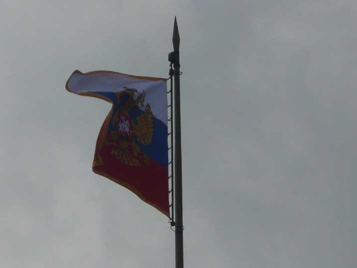 The Presidential standard of Russia, the Russian flag with the two headed eagle on the Kremlin Palace