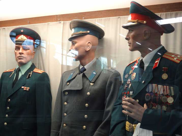 Three Soviet parade uniforms, on the right a Regimental commander of a Soviet Tank Division awarded many medals and badges