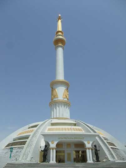 White dome shaped Independence monument decorated with gold