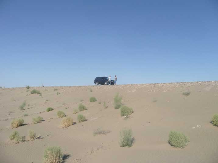 Our car in the Turkmenistan Karakum desert for a sanitary stop