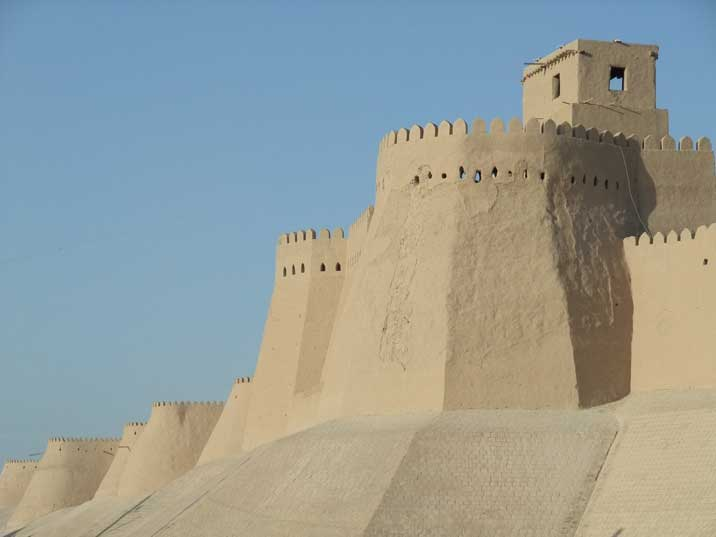 Khiva's ancient city walls made from mud brick in the desert sun