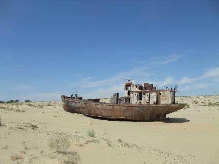 Soviet era fishing vessels rusting away in the Aral Sea desert