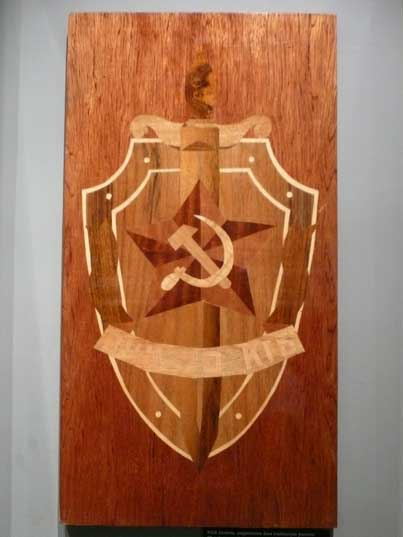 A wooden plaque with KGB shield celebrating its 70th anniversary