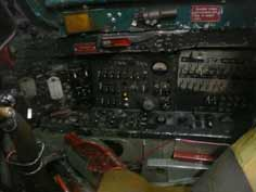 Side panel with many switches inside the cockpit of the MiG-21