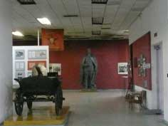 Statue of Frunze inside the Museum exposition, also a coach that was used during the Russian Revolution