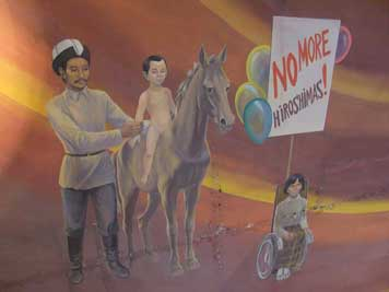 A girl in a Wheelchair demonstrates against nuclear weapons and reminds the world of Hiroshima, a nomad boy represents the innocence of the youth