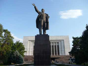 A large Lenin statue with a familiar pose, guiding his sheep on the path of socialism to a bright future