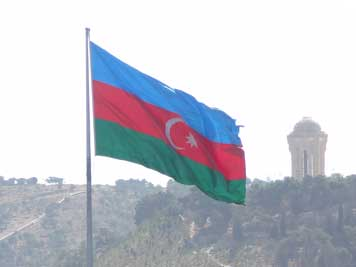 The Azerbaijan flag with the blue band referring to Turkic heritage, red to progress and the green band represents Islam