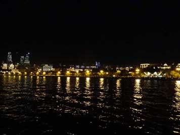 Baku seen at night from the Caspian Sea with the well lighted boulevard and the famous Soviet era Pearl Cafe