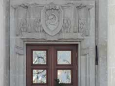 Soviet hammer and sickle carved in marble above the door of the former Lenin museum in the capital of Azerbaijan