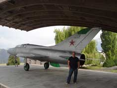 Comtourist editior posing in front of the MiG-21 belonging to the Mikoyan Brothers Museum in Sanahin Armenia