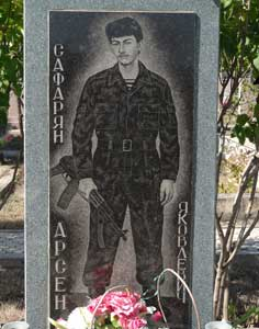 Grave with a photograph of a Armenian soldier who died during the Nagorno-Karabakh Independence war