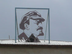 Beautifully crafted Lenin profile on the roof of a building in Balykchy