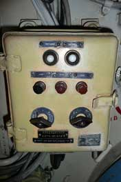 Box with switches to operate a system in the electrical room