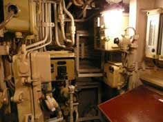 Many water pipes, switches, leavers and instruments in the B-515