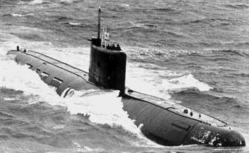 Soviet Tango class submarine at full speed in rough sees