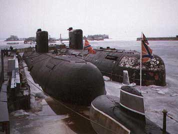 Two Tango class submarines in the icy port of Murmansk Russia