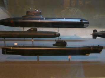 Various Soviet submarine models displayed inside the B-413