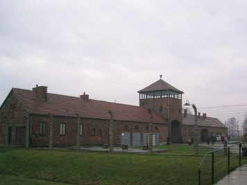 The entrance gate to Auschwitz II Birkenau Concentration Camp where the death trains entered the camps