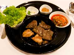 The Korean dish Bulogi, marinated barbecued beef and chicken served with vegetables and Kimichi the national dish of Korea