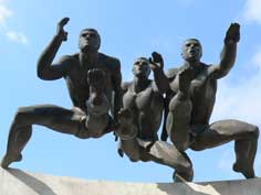 Sculpture of 3 athletes on the National Stadium in Minsk