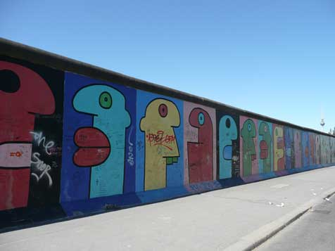 The cartoon faces painted by Thierry Noir are one of many famous works of art that were displayed oin the East Side Gallery wall