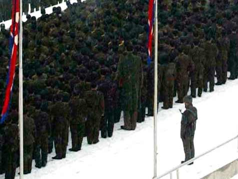 A giant was spotted between North Korean soldiers paying their last honor to Kim Jong Il at his funeral