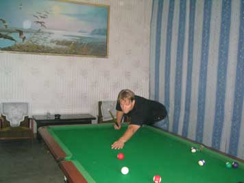Playing pool in the recreation area of the Folklore Hotel