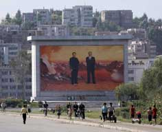 Propaganda billboard with Kim Il Sung and Kim Jung Il in Nampho