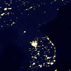 Satellite image of the Korean peninsula, the North is dark