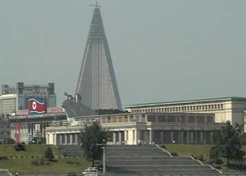 The unfinished giant Ryugyong Hotel towering over Pyongyang